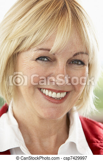 Portrait Of Middle Aged Woman Smiling At Camera - csp7429997