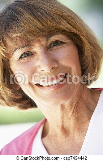 Portrait Of Middle Aged Woman Smiling At The Camera - csp7434442