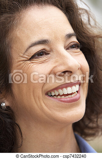 Portrait Of Middle Aged Woman Smiling - csp7432240