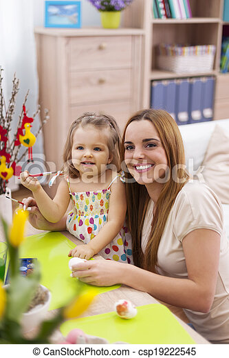 Portrait of mother and her little baby in easter holiday - csp19222545