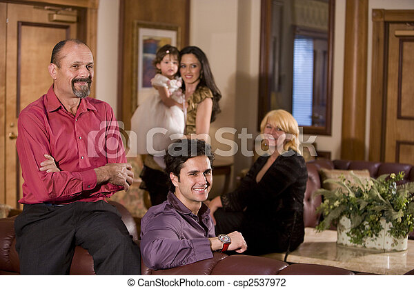 Portrait of multi-generation family in living room - csp2537972