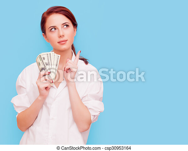 Portrait of redhead woman with money - csp30953164