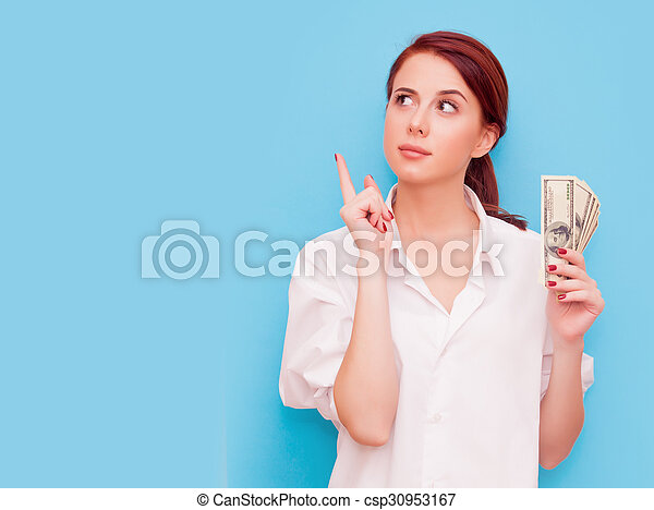 Portrait of redhead woman with money - csp30953167