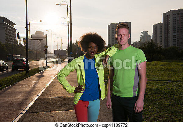 Portrait of romantic pretty couple on fitness session, outside town background - csp41109772