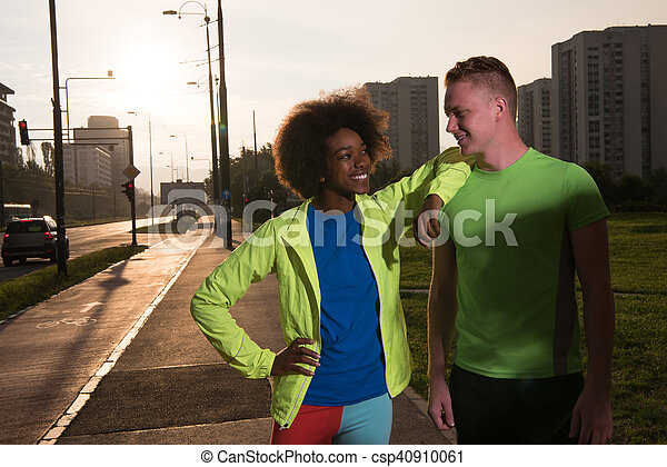 Portrait of romantic pretty couple on fitness session, outside town background - csp40910061
