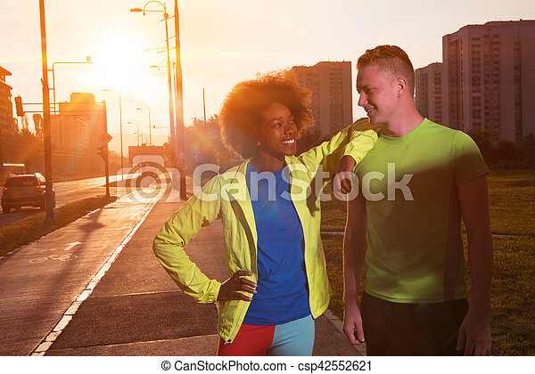 Portrait of romantic pretty couple on fitness session, outside town background - csp42552621