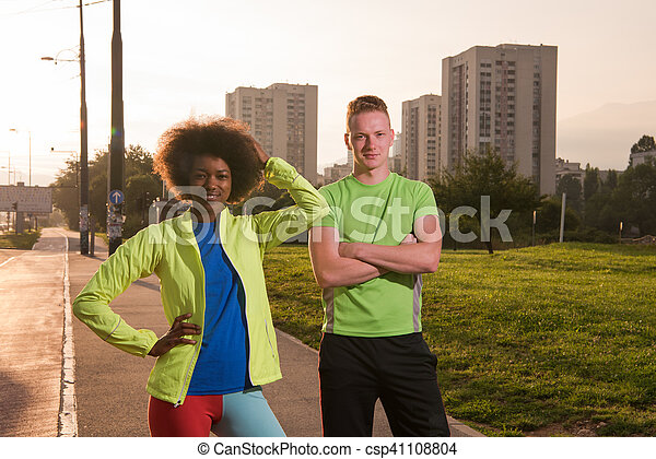 Portrait of romantic pretty couple on fitness session, outside town background - csp41108804