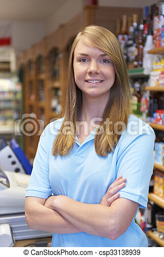 Portrait Of Sales Assistant At Supermarket Checkout - csp33138939