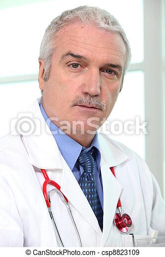 Portrait of senior general practitioner - csp8823109