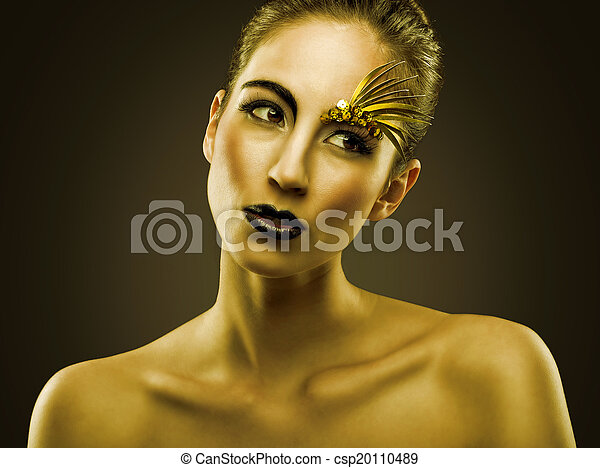 Portrait of sexual beautiful girl with luxury gold makeup - csp20110489