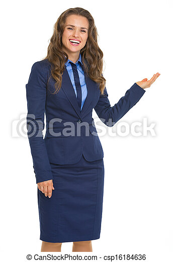 Portrait of smiling business woman pointing on copy space - csp16184636