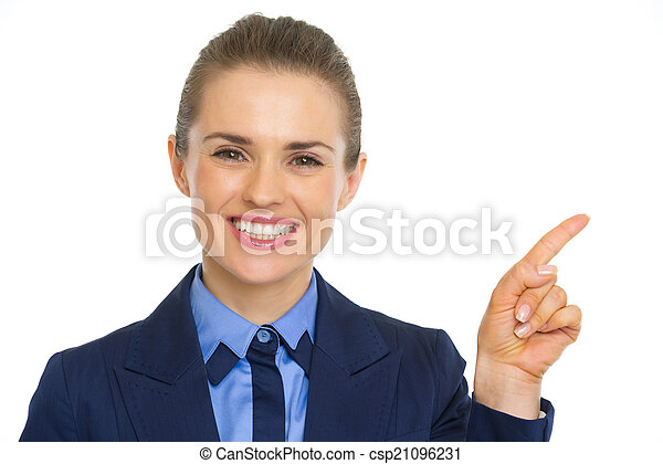 Portrait of smiling business woman pointing on copy space - csp21096231