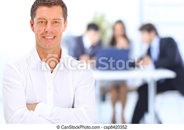 Portrait of smiling businessman in office - csp8420352