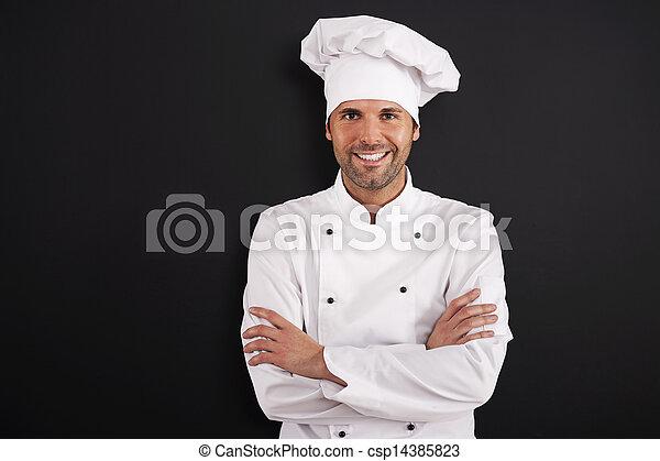 Portrait of smiling chef in uniform  - csp14385823