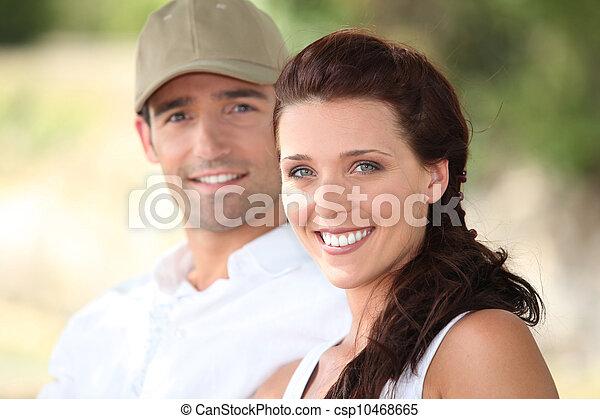 Portrait of smiling couple - csp10468665