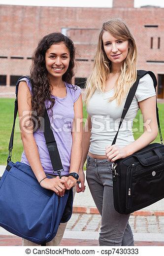 Portrait of smiling female students posing - csp7430333