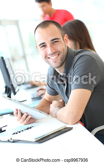 Portrait of smiling student in training course - csp9967936