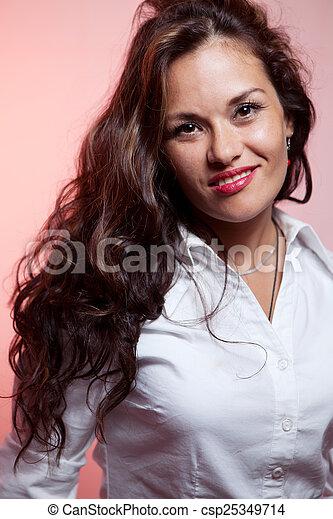 Portrait of smiling woman - csp25349714