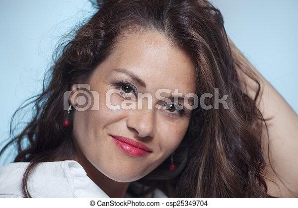 Portrait of smiling woman - csp25349704