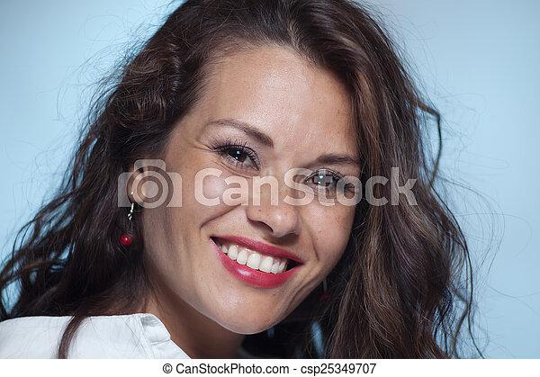 Portrait of smiling woman - csp25349707