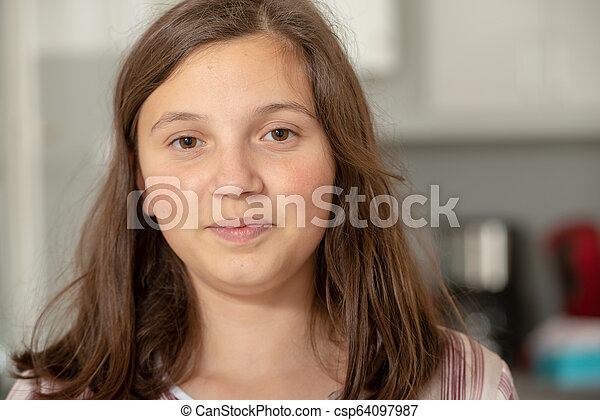portrait of smiling young teenage girl - csp64097987