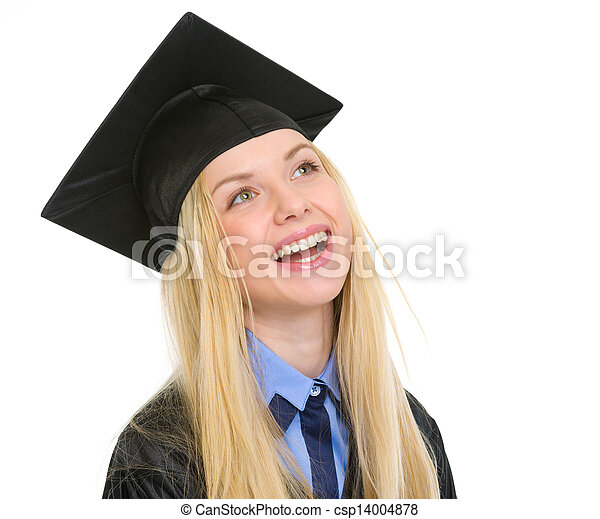 Portrait of smiling young woman in graduation gown looking on copy space - csp14004878