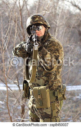 Portrait of soldier with a gun - csp8450037