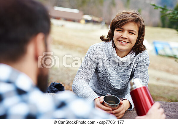 Portrait of teenage hiker drinking tea - csp77061177