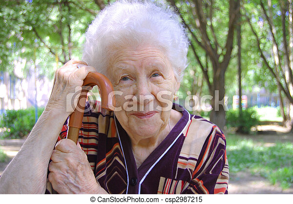 Portrait of the old woman on a green background - csp2987215