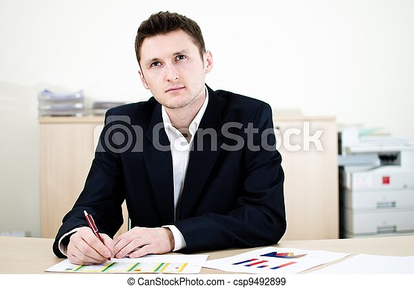 Portrait of thinking businessman or other professional occupation - sitting in office - csp9492899