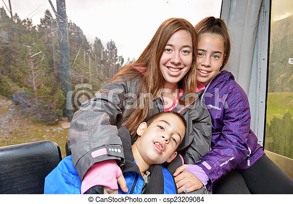 portrait of three siblings hugging in a cable car portrait of three