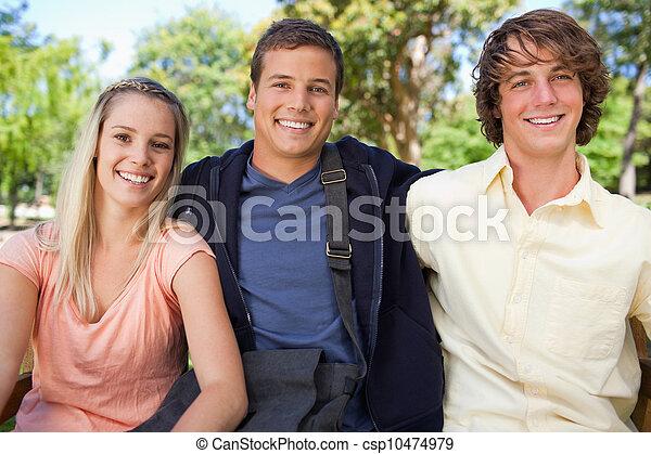 Portrait of three smiling students - csp10474979