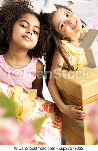 Portrait of two cute girls with the gifts - csp27579032