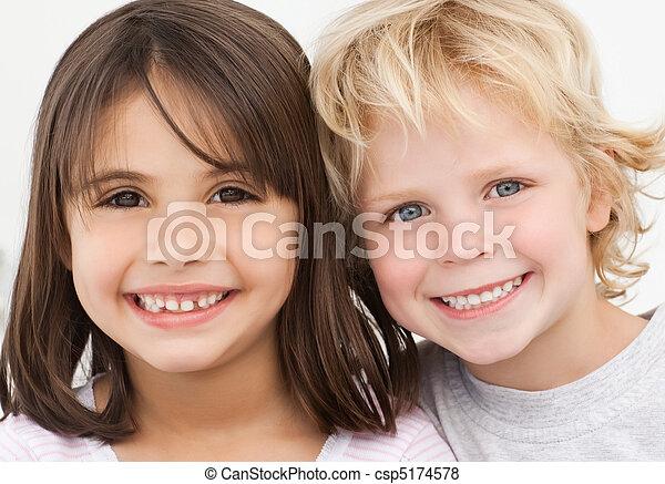 Portrait of two happy children in the kitchen - csp5174578