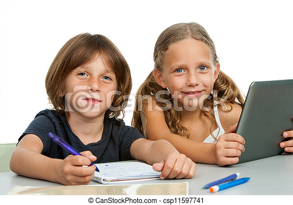 Portrait of two young students at desk. - csp11597741