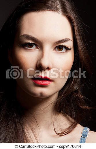 portrait of woman on dark background - csp9170644