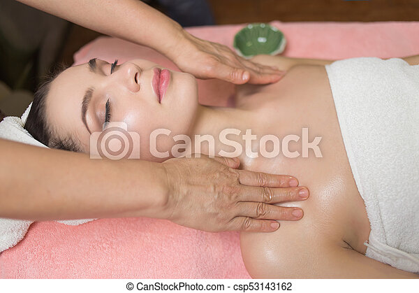 Portrait of woman patient in ayurveda spa wellness center lying relaxed