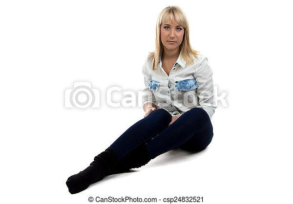 Portrait of woman sitting on the floor - csp24832521