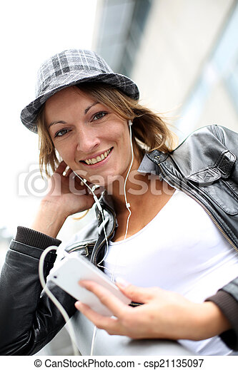 Portrait of woman using smartphone in town - csp21135097