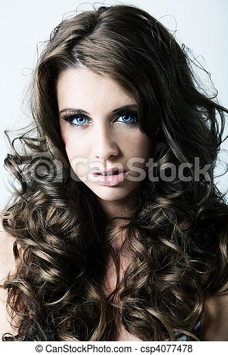 Portrait of woman with blue eyes and long curly hair - csp4077478