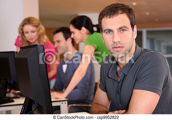 Portrait of young adult attending training class - csp9952822