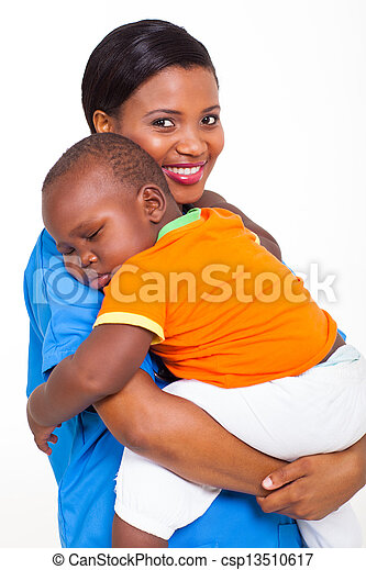 portrait of young african nurse carrying sleeping baby boy - csp13510617