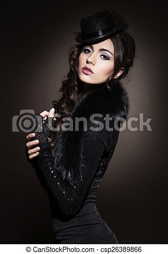 Portrait of young and beautiful woman in retro style - csp26389866