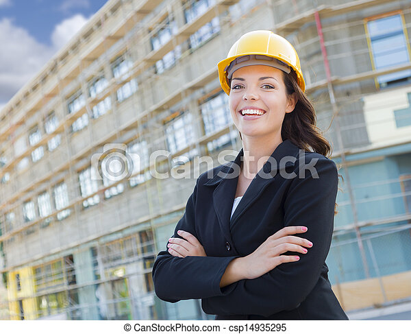 Portrait of Young Attractive Professional Female Contractor Wearing Hard Hat at Construction Site. - csp14935295
