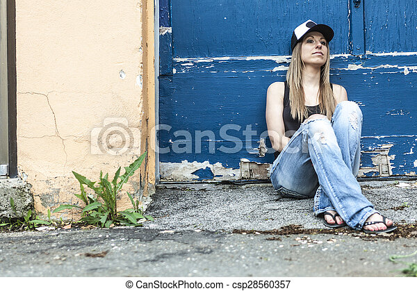 Portrait of young beautiful skater woman posing - csp28560357