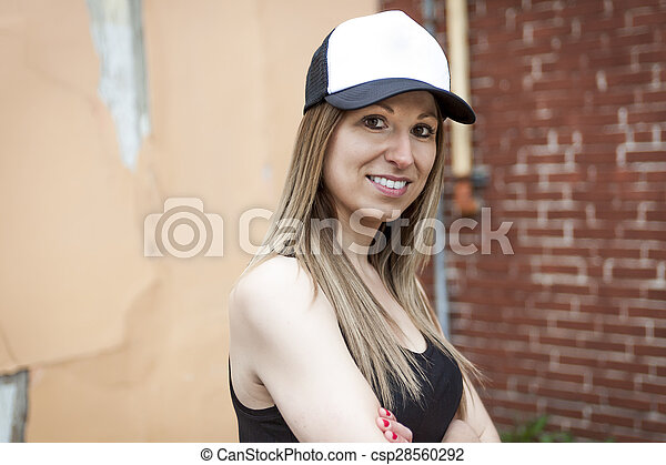 Portrait of young beautiful skater woman posing - csp28560292