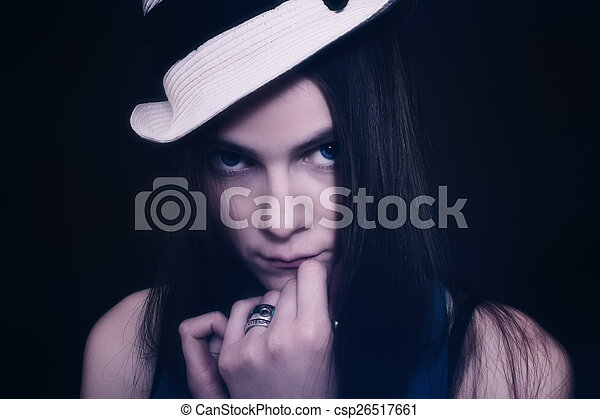 Portrait of young blue-eyed girl in white hat - csp26517661