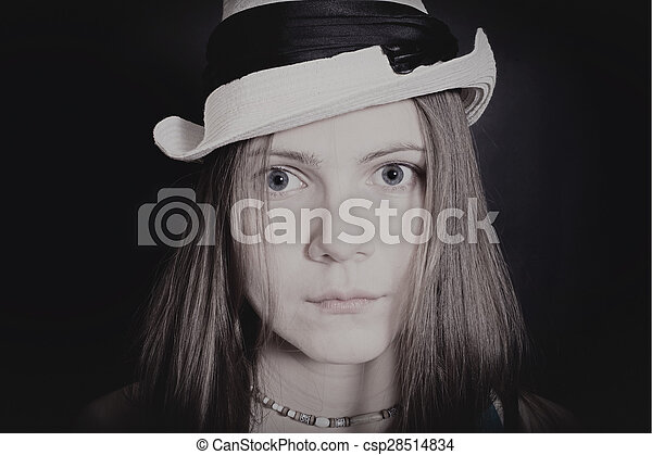 portrait of young blue-eyed girl in white hat - csp28514834