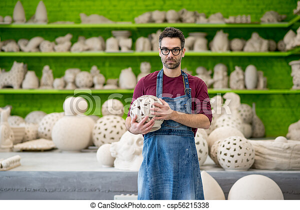 Portrait of Young Ceramist in the Modern Ceramic Workshop. Small Business Concept. - csp56215338