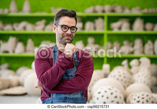 Portrait of Young Ceramist in the Modern Ceramic Workshop. Small Business Concept. - csp56215731